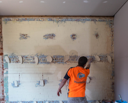 Application of Adhesive for New Wall